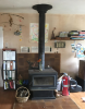 A woodstove in the CCAT common room served as the only source of space heating in the building as of 2019